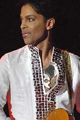 Prince at Coachella in 2008 by Micahmedia at en.wikipedia, CC BY-SA 3.0, https://commons.wikimedia.org/w/index.php?curid=13466179