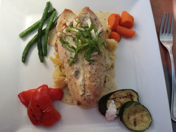 Stuffed Chicken Breast with goats cheese, sun-dried tomato, cremini mushrooms, garlic chive mashed potatoes, seasoned vegetables