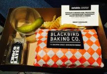 Meal box contained smoked ham, provolone and sauerkraut sandwich from Black Bird Baking Co. and chocolates from Chocolates X Brandon Olsen at Eatable Film Festival