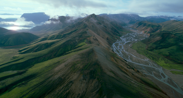 Mountain from Voyage of Time, With its green mountain peaks and braided rivers, the hills of Iceland represent what early Earth may have looked like millions of years ago. © 2016 Voyage of Timek