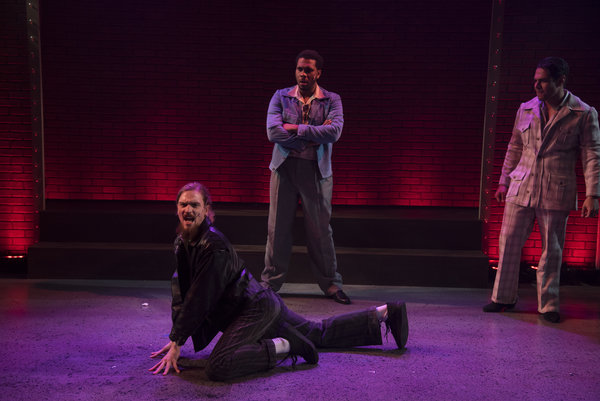 Ed Robinson slithers across the floor as Joey with Brian Gibson as Pablo and Luiz Monterei as TJ in Sister Act at the Lower Ossington Theatre, photo Seanna Kennedy Photography