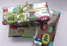 Gifts wrapped in Playful Trees Holiday Roll Wrap, $9.95, from Papyrus