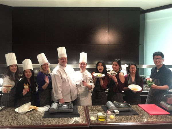 Chefs and media guests pose for a pic at Azure Restaurant