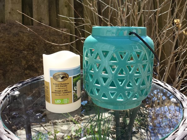Indoor Outdoor LED Candle by Hampton Bay, $5.98, and Hampton Bay Ceramic Lantern in Haze, $11.98, at Home Depot Canada