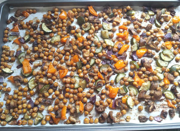 Roast vegetables and chickpeas on parchment paper