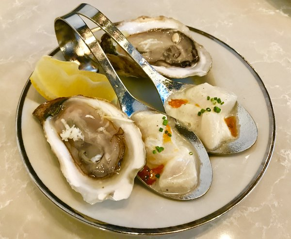 Oysters with spiced scallops at Victor Restaurant, at Le Germain Hotel, Toronto