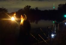The storyteller for Spooky Lagoon: Toronto Island Stories greets us at the dock and guides us with her lantern.
