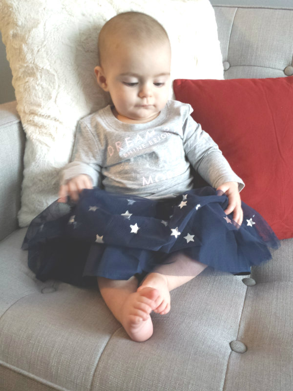 Sofia loves the sparkly silver stars on her OshKosh navy blue tulle skirt.
