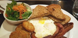 Sunrise Breakfast with fried eggs, bacon, sausage, potato pancakes and green salad at Green Eggplant Mediterranean Grill