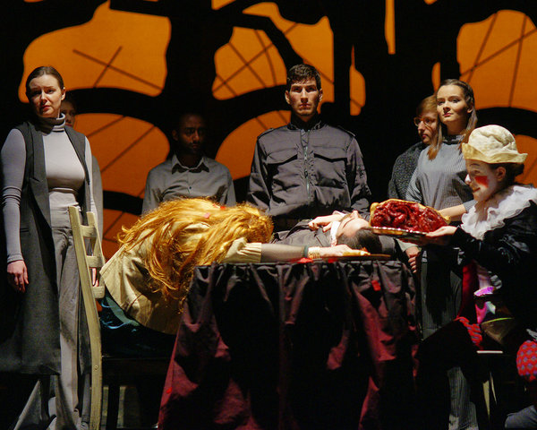 The Company of Titus Andronicus in the final tableau at Hart House Theatre, photo credit Scott Gorman