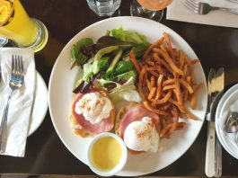 Oeufs Benedicte with black forest ham, toasted English muffins with house Hollandaise sauce at Le Papillon on Front