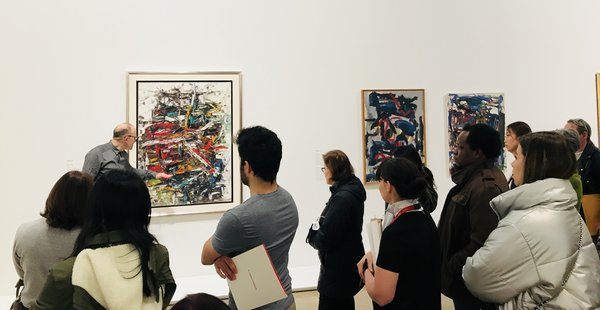 K. Brummel tour group with Riopelle self-portrait at Mitchelle Riopelle Nothing in Moderation at the AGO.