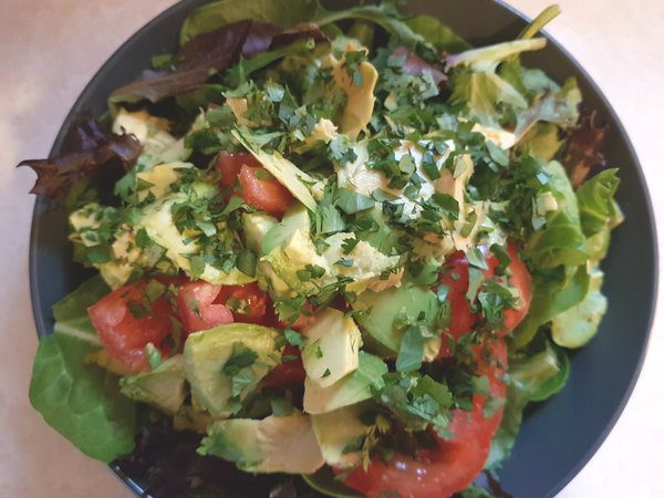 Spring Mix Salad with tomatoes and avocados.