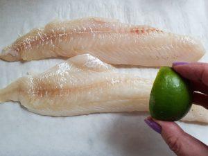 Squeeze fresh lime juice on haddock filets.