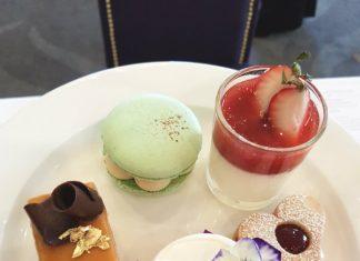 The Lemon & Elderflower Cordial Wedding Cake (front) and other desserts part of Royal Wedding Afternoon Tea at Omni King Edward Hotel