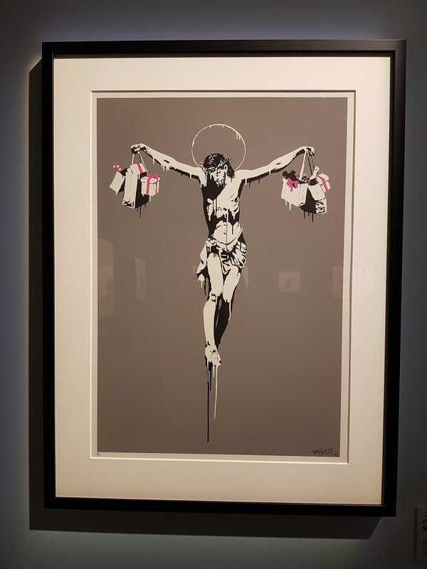 Christ with Shopping Bags by Banksy at The Art of Banksy in Toronto