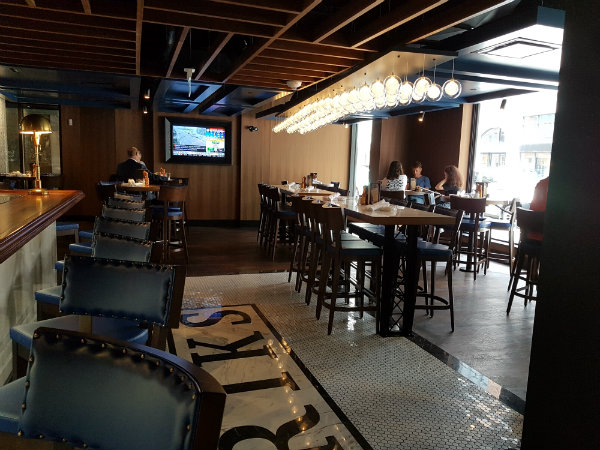 Bar area at Hendriks Restaurant features HDTVs and windows opening on to Yonge Street