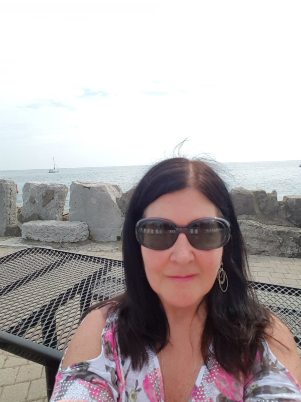Me enjoying the view of Lake Ontario from Vista Eatery at Ontario Place