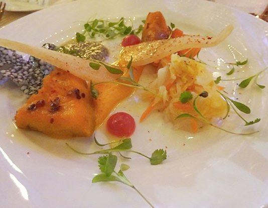 Cookstown Greens Hubbard Squash, White Kimchi, Pears, Pumpkin Pesto & Chicharron by David Lee at Aeroplan Plant Based Dinner at Evergreen Brick Works in Toronto