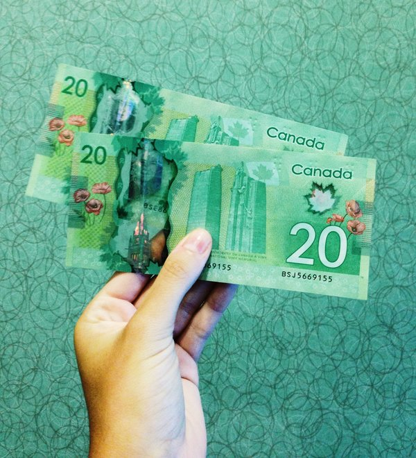 Canadian dollars, photo credit Michelle Spollen on Unsplash