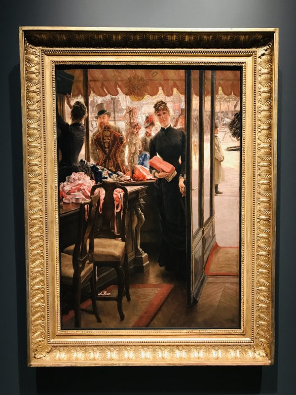 James Tissot's The Shop Girl at Impressionism in the Age of Industry: Monet, Pissarro and more