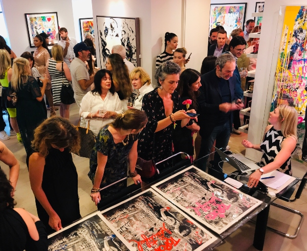 Print Purchasing at Mr. Brainwash at Taglialatella Galleries in Toronto.