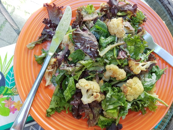 Roasted Cauliflower and Onion Salad with Lemon Tahini Dressing makes a great summer salad.
