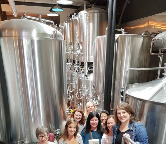 Our BooknBrunch group in front of beer tanks at Eastbound Brewing Co. on Queen St. E.
