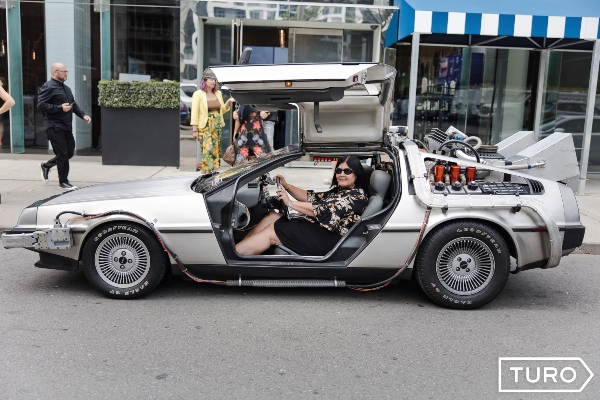 Me behind the wheel of a DeLorean at Bask-It-Style 2019, photo credit jess baumung