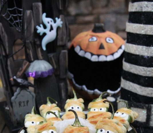 These adorable Halloweeño Jalapeño Popper Mummies will be a hit at your Halloween party, photo credit The Hopeless Houswife