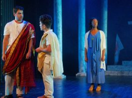 Yusuf Zine as Julius Caesar, Felix Beauchamp as Marcus Brutus and Whitney K. Ampadu as Calpurnia in Portia's Julius Caesar at Hart House Theatre in Toronto