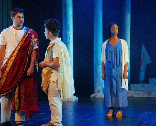 Yusuf Zine as Julius Caesar, Felix Beauchamp as Marcus Brutus and Whitney K. Ampadu as Calpurnia in Portia's Julius Caesar at Hart House Theatre in Toronto