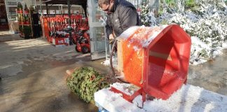 Home Depot Canada employee wraps our Christmas tree in twine.