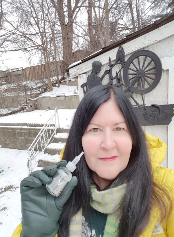 Me holding Vichy LiftActiv Supreme H.A. Wrinkle Filler in our snow-covered backyard.