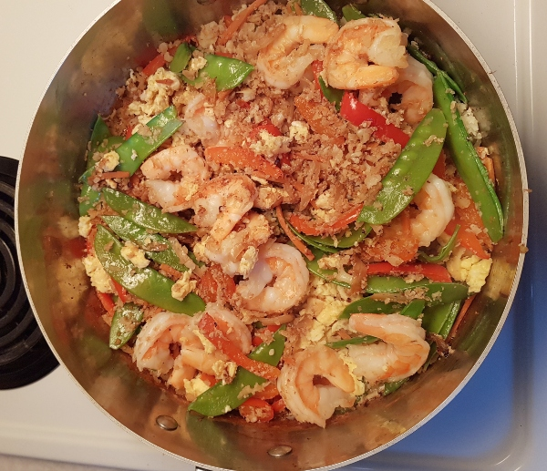Add the shrimps and scrambled eggs to saucepan, then add Tamari sauce and combine well.