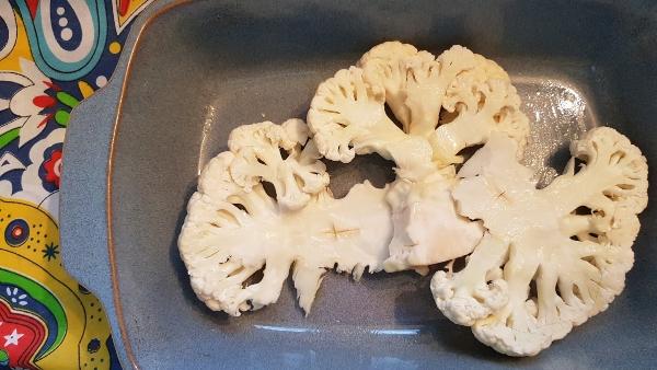 Cut cauliflower in half from top to bottom, then slice each half into three steaks.